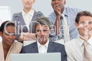 Serious Multi-ethnic business people using a laptop