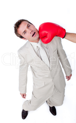 Caucasian businessman being hit with a boxing glove