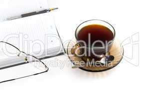 daily planner and cup of coffe