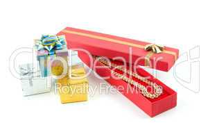 gold necklace in red box