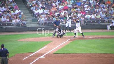 Batter Hits Fly Ball