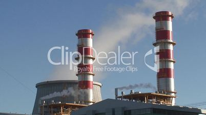 Power plant, cooling towers emitting steam