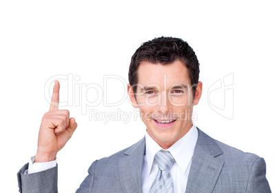 Confident businessman pointing upward