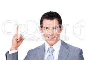 Confident businessman pointing upward