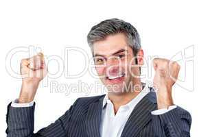 Joyful businessman punching the air in celebration