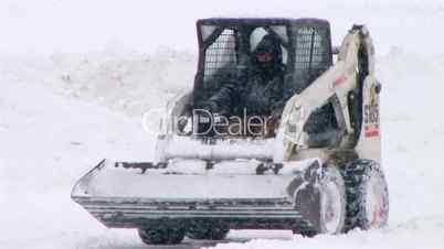 Bobcat Plowing Snow