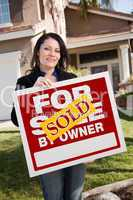 Hispanic Woman Holding Sold For Sale By Owner Real Estate Sign I
