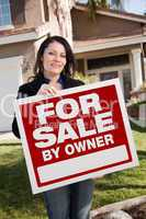 Hispanic Woman Holding For Sale By Owner Real Estate Sign In Fro