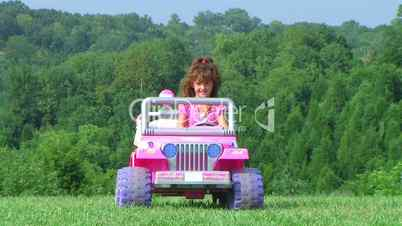 Girl Driving Toy Jeep