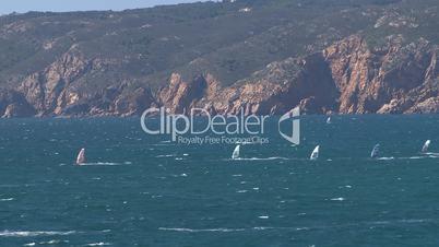 Kitesurfers in action on beach