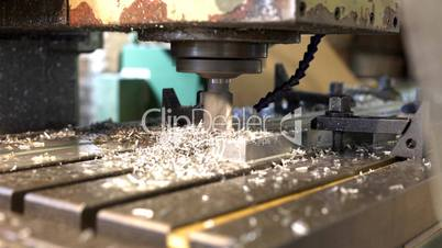 Machine drill work with metal close up