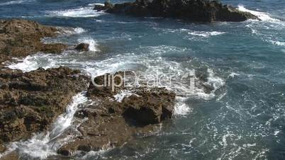 Sea waves against rocks on coast