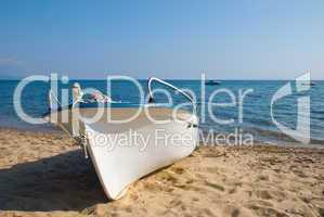 Plastic boat on beach