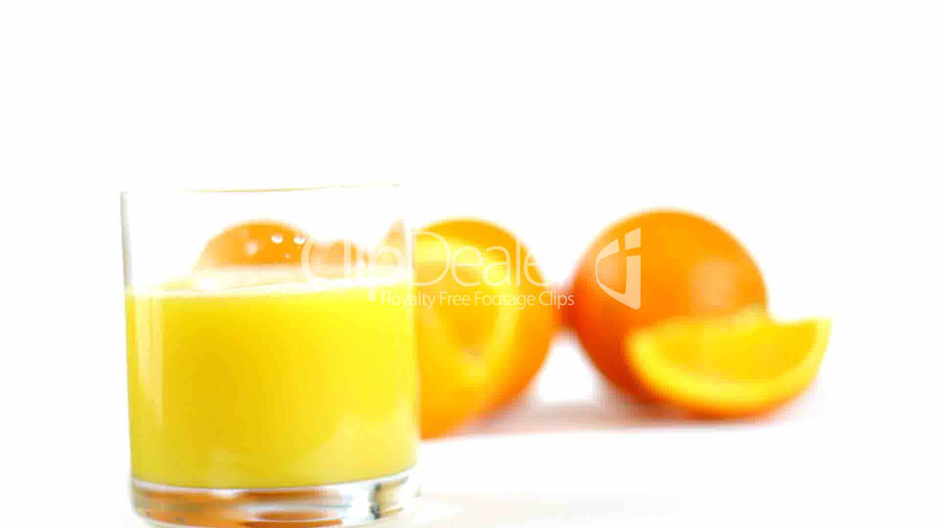 Pouring orange juice into glass: Royalty-free video and ...