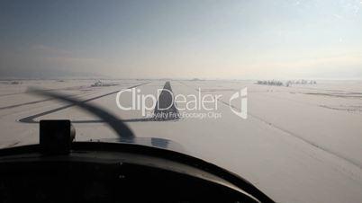 Aerial Cessna landing from cockpit