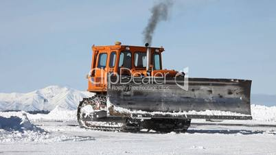 Caterpillar clearing snow off road