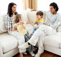 Lively family having fun in the living room