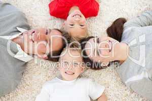 Jolly family lying on the floor