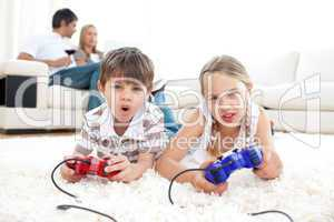 Lively children playing video games