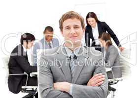 Caucasian businessman sitting in front of his team
