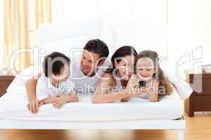 Happy family having fun in the bedroom