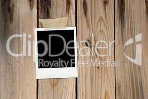 Grunge wood background with photo card