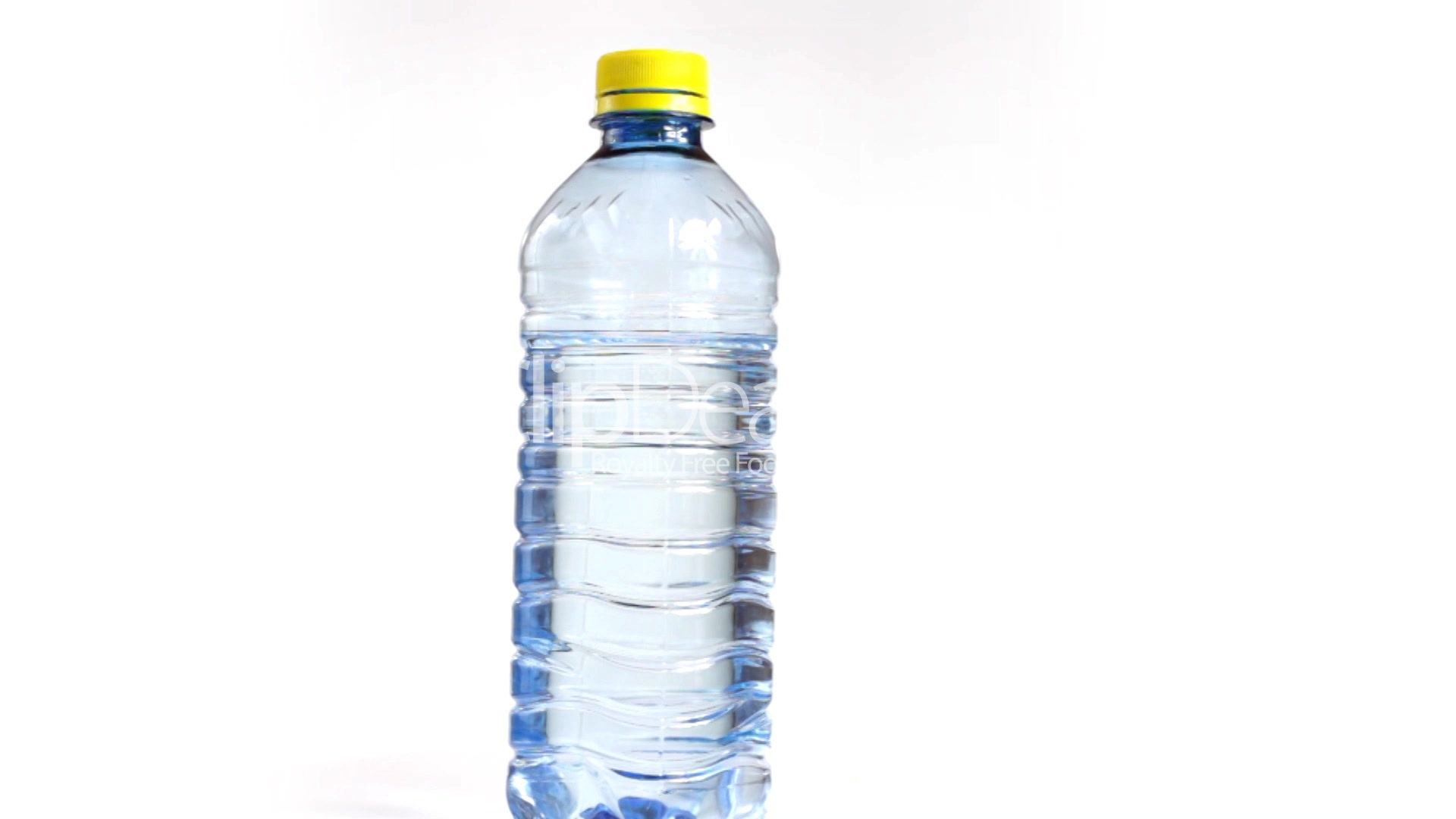 close up of rotating bottle of water isolated on a white background