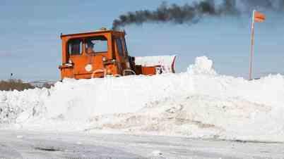 Caterpillar pushing snow