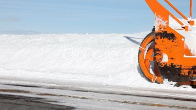 Snow blower close on mountain road