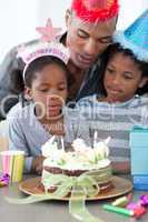 Cute little girl and her family celebrating her birthday