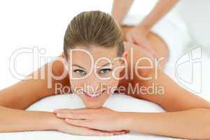 Peaceful woman enjoying a massage