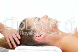 Blond woman enjoying a hair massage