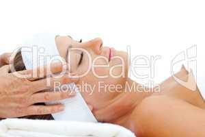 Relaxed woman enjoying a head massage