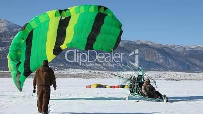Powered parachute takeoff winter snow