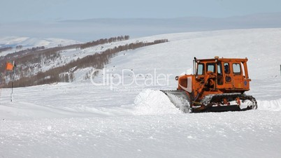 Snow plow cat in mountain