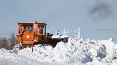 Snow Plow Caterpillar clearing road