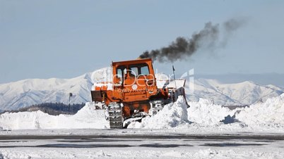 Snow plow caterpillar mountain snow