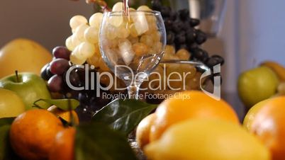 Fresh fruits and pouring wine – dolly shot