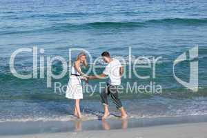 Loving couple having fun at the shore line