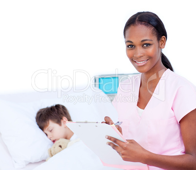 Confident doctor making notes on a patient's clipboard
