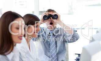 Charismatic businessman looking through binoculars