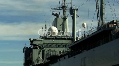 Royal navy ship being towed into dock