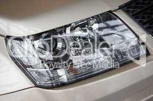 headlight on a beige car