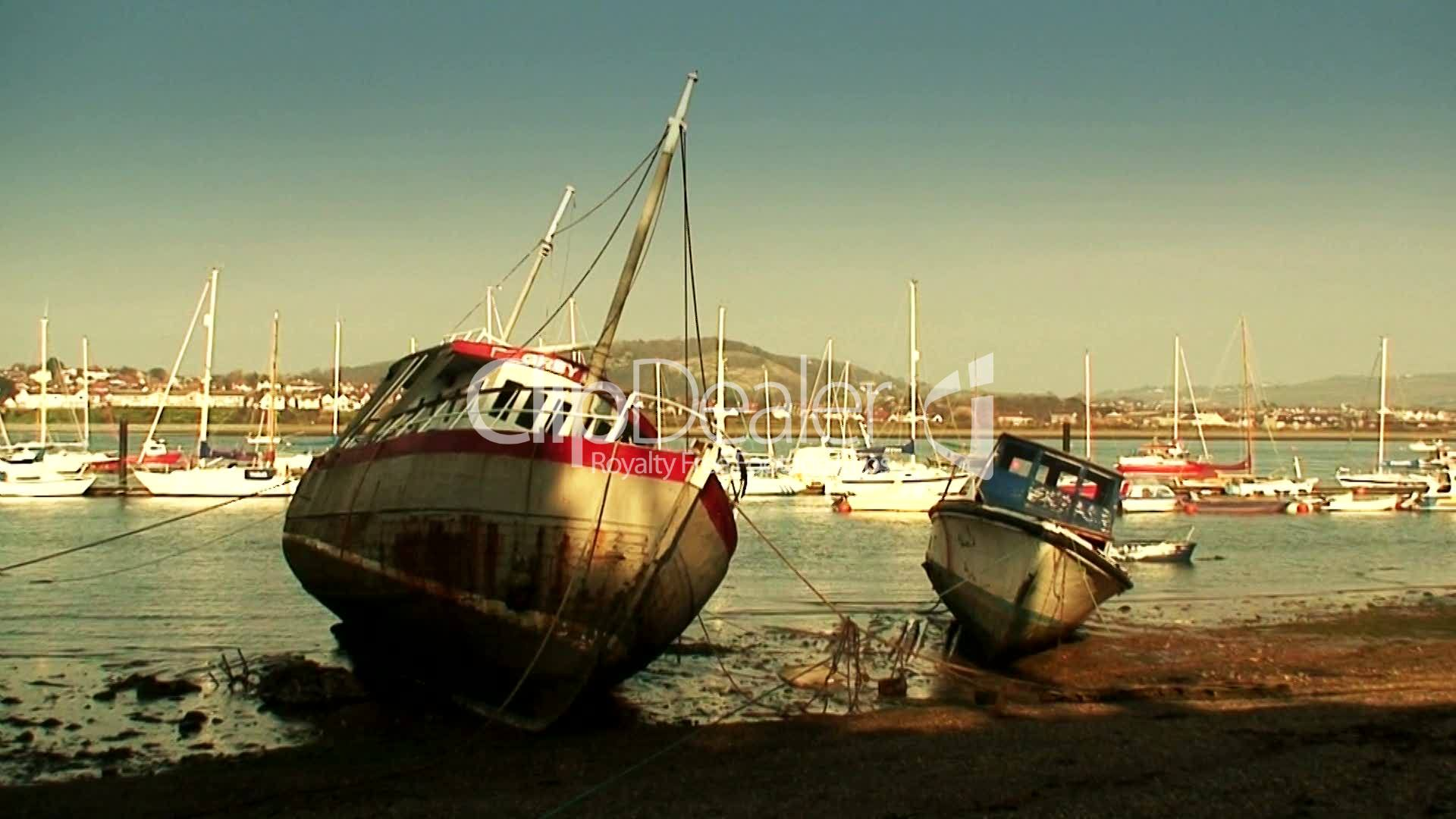 Small fishing boats at low tide lizenzfreie stock videos for Mini fishing boats