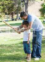 Attentive father teaching baseball to his son