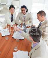 Cheerful Business associates closing a deal