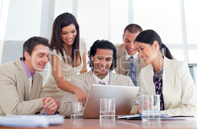 Cheerful business partners working at a computer
