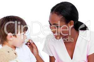 Smiling doctor taking child's temperature