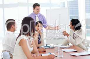 Charming businessman doing a presentation