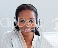 Charismatic businesswoman using headset at her desk